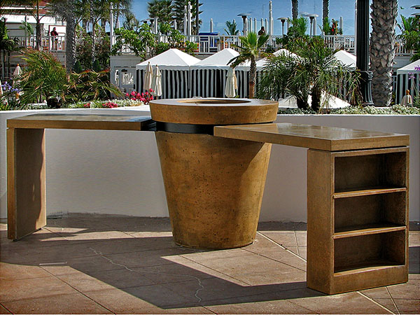 outdoor concrete fire pit with dining tables attached in rustic ocher eno bar del coronado hotel san diego