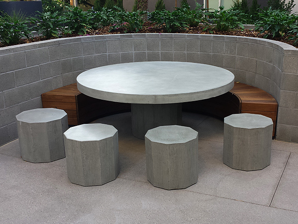 concrete table and hexagonal stools with ipe wood semicircle bench