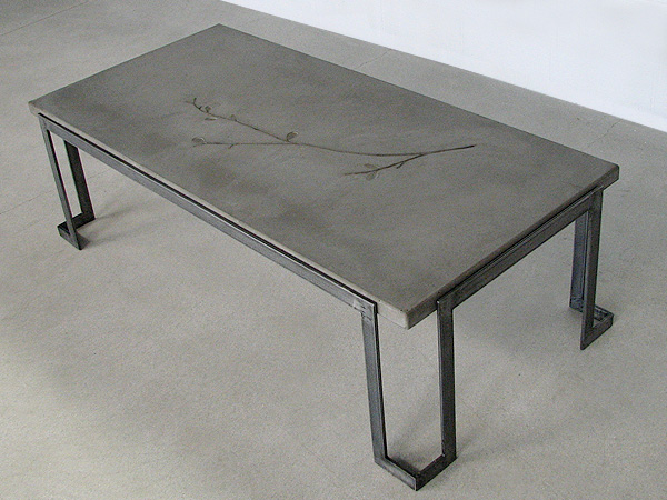 Charming Coffee Table With Concrete Top In Natural Gray With Tree Branch Impression  And Flat Metal Base